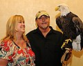 Posing for picture with Bald Eagle. (10596293635).jpg
