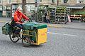 Postbud på trehjulet elcykel i Park Allé, Aarhus.jpg