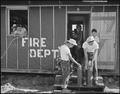 Poston, Arizona. Army type fire extinguishers are being examined by evacuees Eiichi Omori and Georg . . . - NARA - 536094.tif