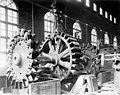 Powerhouse interior showing placement of water wheel and rotor shaft in no 3 generating unit bearings, June 8, 1904 (SPWS 480).jpg