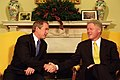 President Bill Clinton and President-Elect George W. Bush shake hands during their meeting in the Oval Office.jpg