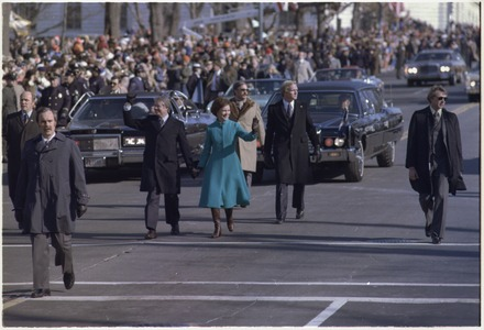 President Jimmy Carter and Rosalynn Carter walk down Pennsylvania Avenue during Inauguration. President Jimmy Carter and Rosalynn Carter walk down Pennsylvania Avenue during Inauguration. - NARA - 173376.tif