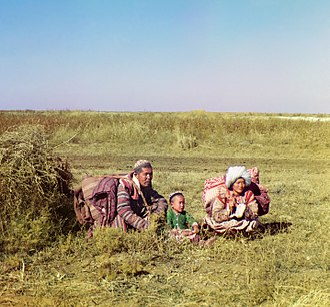 Khalat - Kyrgyz family wearing khalats, 1911