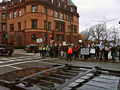 Protesters standing across from church.jpg