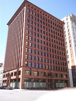 Prudential (Guaranty) Building - Prudential (Guaranty) Building. The three zones of Sullivan's design are visible in the large open windows of the ground zone, the thin vertical elements of the office zone and the arches and curves of the terminating zone at the top of the building.