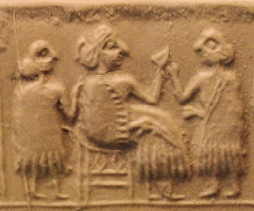 Queen Puabi seated, with attendants, circa 2600 BC. Queen Puabi with attendants.jpg