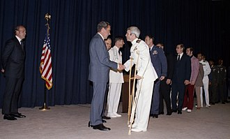 John McCain - Lieutenant Commander McCain greeting President Richard Nixon in May 1973
