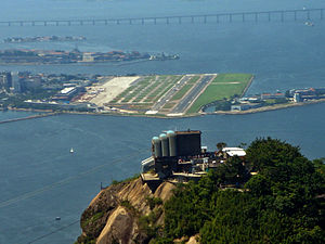 Santos Dumont Airport - Aerial view of Santos Dumont location. The Rio-Niterói Bridge in the background, and the Sugar Loaf (Pão de Açúcar) in the foreground.