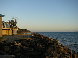 Somers, Victoria - Rock Seawall protecting Somers Yacht Club on Somers Beach.
