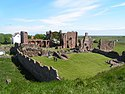 Ruins of Lindisfarne Priory and St Aidan's statue - geograph.org.uk - 189125.jpg