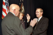 Rumsfeld is sworn in by David O. Cooke as Secretary of Defense, January 20, 2001.