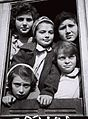 """SOME OF THE """"TEHERAN CHILDREN"""" IN THE WINDOW OF THE TRAIN TAKING THEM FROM ATLIT TO YOUTH VILLAGES THROUGHOUT THE COUNTRY. קבוצה של """"ילדי טהרן"""" בחלון D842-074.jpg"""