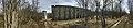 Salangsverket Concrete ruins of industrial iron ore mining 1907–1912 Langneset Sagfjorden Salangen Troms Northern Norway springtime naked trees Distorted panorama 2019-05-07 8340.jpg