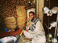 Salesman selling and smoking 'Huqa' near Delhi Gate Lahore.jpg