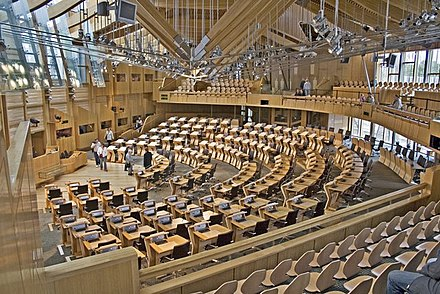 The debating chamber of the reconvened Scottish Parliament from the public gallery. Scottish Parliament, Main Debating Chamber - geograph.org.uk - 1650829.jpg