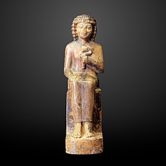 Seated man holding a nenufar-N 1581