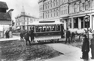King County Metro - Seattle Street Railway's first streetcar at Occidental Avenue and Yesler Way with Mayor John Leary and city officials in the fall of 1884