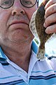 Selfie Peter van der Sluijs with a small flounder.jpg