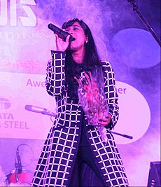 Shilpa Rao singing a song with a bouquet