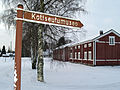 Sign pointing to museum, Isokyrö Finland.jpg