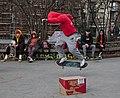 Skateboarder jumping over a cardboard box at Skatepark des Ursulines in Brussels, Belgium (DSCF4497-cropped).jpg