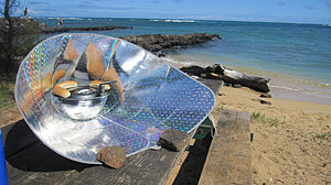 Solar cooker - Hot dogs being cooked with a solar funnel cooker