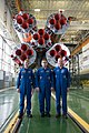 Soyuz TMA-19M crew in front of the Soyuz booster rocket.jpg