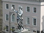 Statue of a muse on the Clarendon Building.jpg
