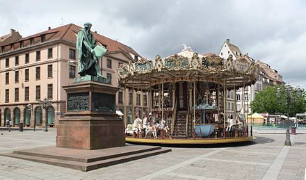 Place Gutenberg with statue of Gutenberg and Carousel. Strasbourg place gutenberg.jpg