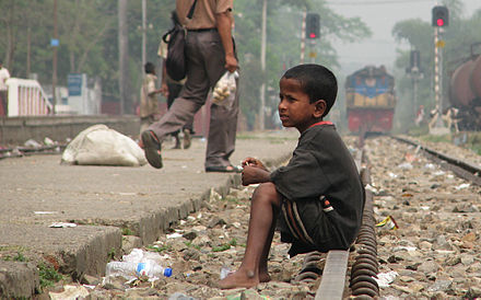 Street child in Bangladesh. Aiding relatives financially unable to but willing to take in orphans is found to be more effective by cost and welfare than orphanages. Street Child, Srimangal Railway Station.jpg