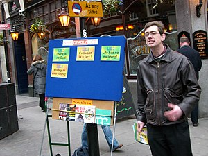 Street preacher in Covent Garden using a prese...
