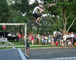 Stunt bicyclist Chris Clark does aerial jump in demonstration in Summit NJ.jpg