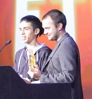 """FTL: Faster Than Light - Justin Ma (left) and Matthew Davis, the two-man team behind FTL, at the 2013 Game Developers Conference receiving the """"Excellence in Design"""" Independent Games Festival award"""