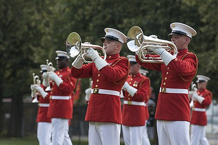 The United States Marine Drum and Bugle Corps performed at the Marine Corps War Memorial in 2015. Sunset Parade 150728-M-EL431-069.jpg