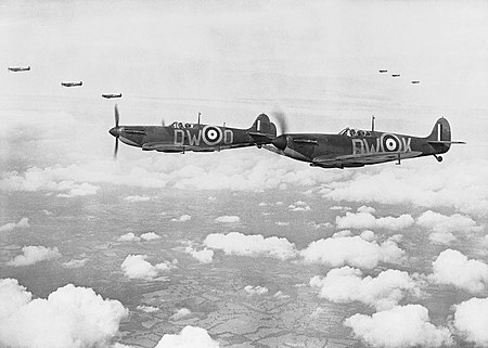 Supermarine Spitfire Mark Is of No. 610 Squadron based at Biggin Hill, flying in 'vic' formation, 24 July 1940. CH740