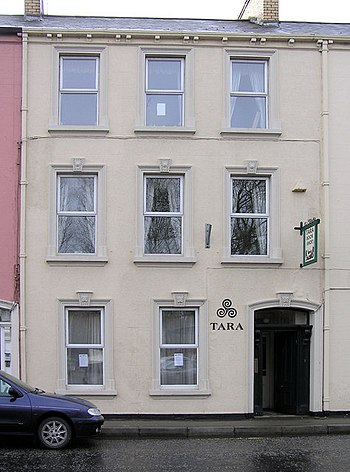 English: TARA, Omagh. The Tara Counselling & Personal Development Centre situated in the busy Holmview Terrace, Campsie, Omagh is a retreat from the hustle and bustle of modern life. Opened in 1996, the Centre recently added a major new extension. Beyond the townhouse façade, the design of the new single and a half storey extension leaves no doubt that this is an area of peace and calm.
