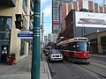 TTC streetcars 4150 and 4154 head west on King near Spadina, 2014 12 20 (1) (16071584301) (2).jpg