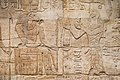 Taharqa and the gods of Gematen (the Temple of Kawa). He makes an offering to the ram-headed god Amun-Re. Kawa shrine.jpg