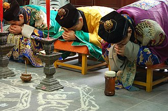 Taoism - Priests of the Zhengyi order bowing while officiating a rite at the White Cloud Temple of Shanghai