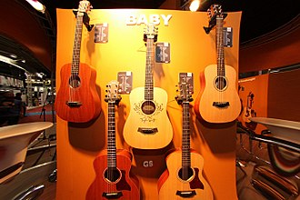 Travel guitar - Image: Taylor Swift Baby Taylor (center), Taylor Baby Taylor series (sides), & GS Mini (bottom) Expomusic 2014 edit