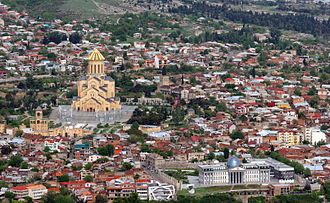 Holy Trinity Cathedral of Tbilisi - Sameba seen in the Elia neighborhood along with the new Presidential Administration