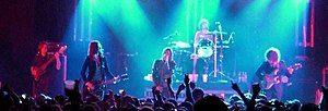 Band (rock and pop) - The Strokes are a five-part band with a lead vocalist, two guitarists, bassist, and drummer lineup.