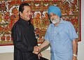The Chief Minister of Mizoram, Shri Lal Thanhawla meeting the Deputy Chairman, Planning Commission, Shri Montek Singh Ahluwalia to finalize annual plan 2009-10 of the State, in New Delhi on March 22, 2010.jpg