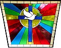 The Dove and Cross. Stained-glass window at Church of Our Savior MCC (Metropolitan Community Church, Church), 2011 South Federal Hwy, Boynton Beach, Florida 33435, USA.jpg