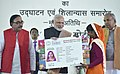 The Prime Minister, Shri Narendra Modi felicitates the beneficiaries of different Government Schemes, at a function, in Varanasi, Uttar Pradesh (2).jpg