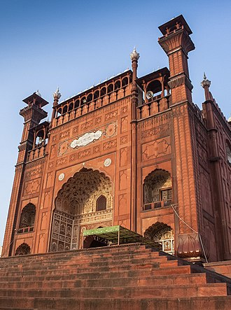 Badshahi Mosque - The Badshahi Mosque features a monumental gateway that faces the Hazuri Bagh quadrangle and Lahore Fort.