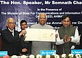 "The Speaker, Lok Sabha, Shri Somnath Chatterjee releasing a Commemorative Postage Stamp on ""The Tribune"", in the presence of the Minister of State for Communications and Information Technology, Dr. Shakeel Ahmad.jpg"