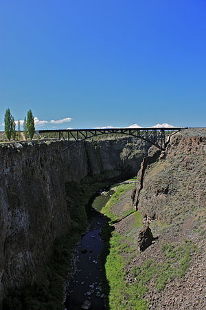 Deschutes County, Oregon - Three Sisters mountains visible over the Crooked River Railroad Bridge north of Terrebonne