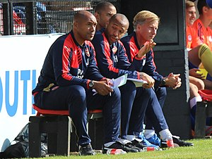 Andries Jonker - Jonker with fellow coaches Theirry Henry and Jason Brown at Arsenal