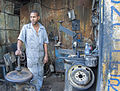 Tire Mechanic, Havana Jan 2014, image by Marjorie Kaufman.jpg